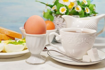 Easter- traditional Easter breakfast - Festive Easter table in white - soft focus, selective focus