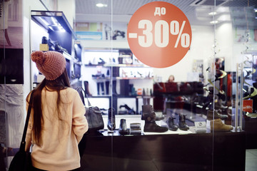 young girl's winter sale shopping center