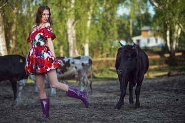 Beautiful girl on the nature close to the bull