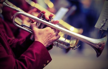 trumpeter plays his trumpet in the brass band