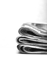 Newspapers. Stack of newspaper. Image in black and white.