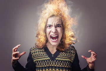 Angry woman yelling, her hair is on fire