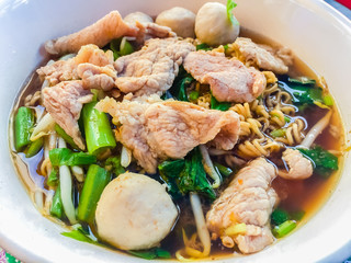 Popular street food in Thailand (Kuai Tiao Moo Namtok) that consisted of pork ball, pork meat, basil or thyme, bean sprouts, morning glory, noodle and creamy soup.