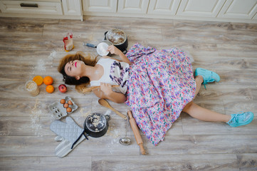 young woman lying on the floor in a vintage kitchen