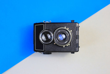 Retro camera. FED, Amateur, Zenith. Blue background