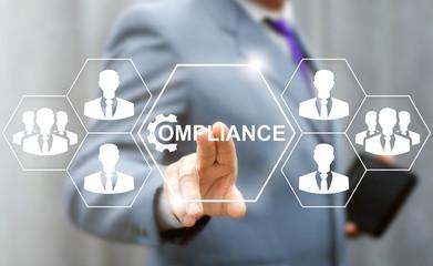Business compliance teamwork service web concept. Businessman presses compliance gear button on virtual hexagon screen. Company strategy finance work support plan success technology