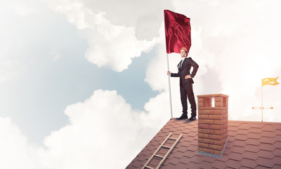 Young businessman with flag presenting concept of leadership. Mi