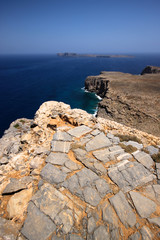Coastal Greece, picture of the rocky coast of Greece , with blue skies and clear waters