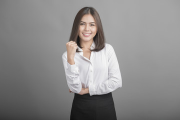 Beautiful Business Woman confident on grey background