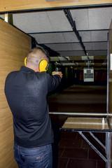 man shoots gun