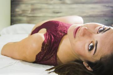 Beautiful woman in underwear on a bed