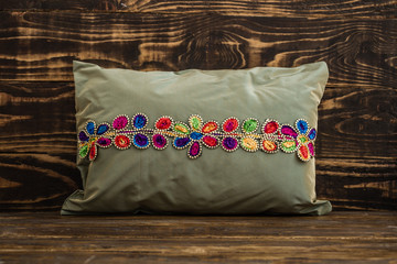 Decorative Green Pillow  on Blue Wooden Background