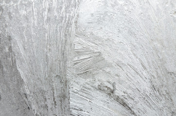 Surface of windowpane with frostwork as a background