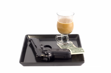 Air gun, coffee class and a dollar on a tray