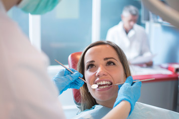 Dentist examining a patient's teeth in the dental office.