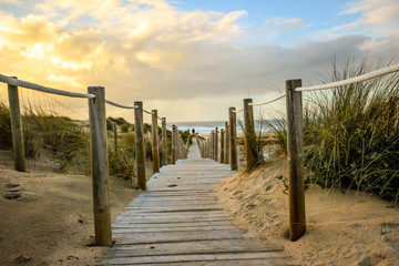 Wooden path to the beach on the dunes. Guincho beach in Cascais, Portugal