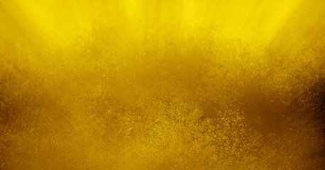 gold sunbeams or streaks of sunshine in the heavens or sky, elegant textured brown gold background design