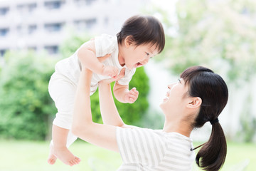 portrait of asian mother and baby in the park