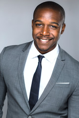Head shot close up of company executive employee worker manager stylish suit and smile