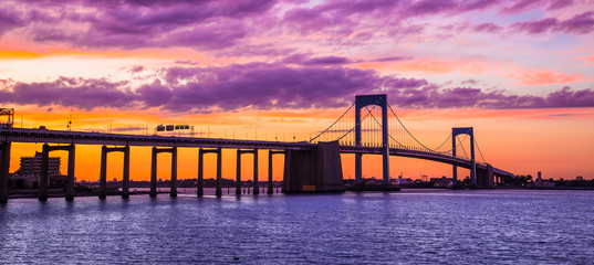 New York City Throgs Neck Bridge from Queens NYC to the Bronx with colorful sunset sky