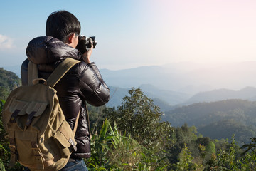 Young professional traveler man with camera shooting outdoor, fa