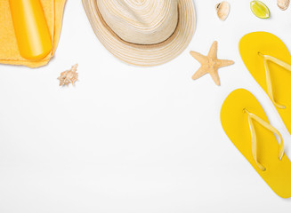 Beach accessories on white background with copy space