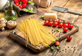 Italian spaghetti with set of ingredients for cooking pasta