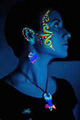 Woman With Fluorescent Make-up And Bijouterie