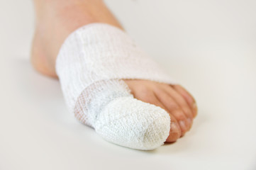 injured toe with bandages Wall mural