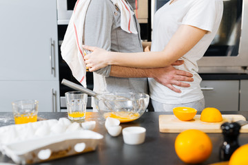 Embrace in the kitchen