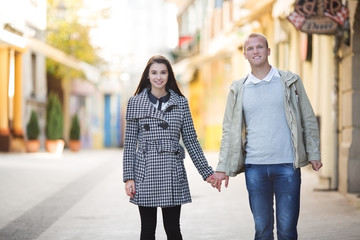 Couple in love walking outdoors and holding hands