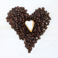 are different and similar simultaneously/ Two heart symbol made from coffee beans and gingerbread top view