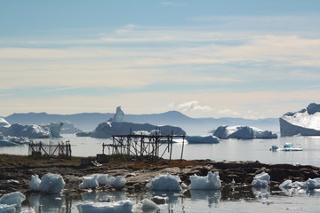 Drying fish on racks, Greenland