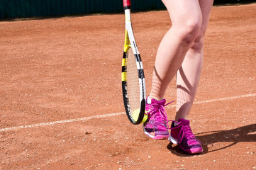 Tennis shoes, racket and ball on the court. Wallpaper.