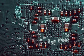 Black electronic circuit background, close up microchip.