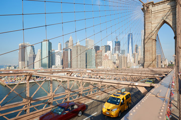 Brooklyn Bridge and New York city skyscrapers view, yellow taxi