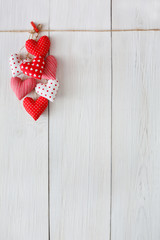 Valentine day background, pillow hearts bunch on wood, copy space