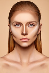 Woman with strokes of foundation on her face
