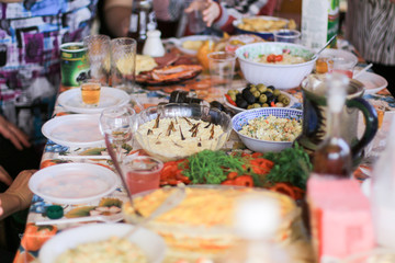 banquet with salads and alcohol drinks in the village