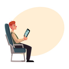 Young man seating in airplane, economy class, holding a tablet or e-book, cartoon vector on background with place for text. Man seating in economy class, airplane passenger, holding tablet, side view