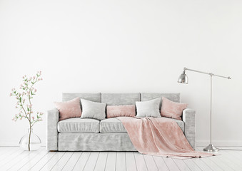 Empty white wall mockup with sofa, pillows, plaid, plant in vase and lamp on the floor. 3D rendering.