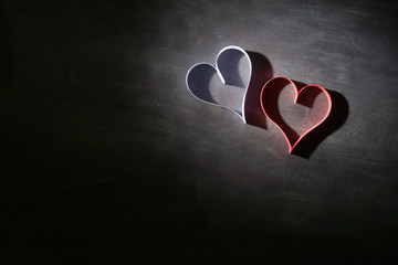 Postcard to Valentine's Day. White and red heart made of paper strips. Dark background. Country for text.