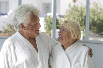 Relaxing happy senior couple looking at each other, after SPA