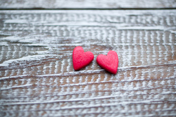 Two red hearts on a wooden background. Valentine's day. Selective focus