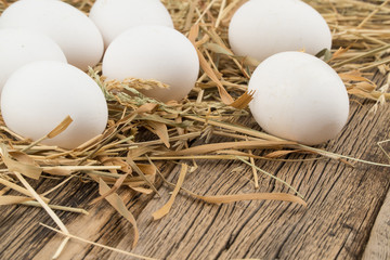 Eggs on wooden background.