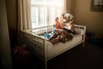 Small group of children playing on day bed