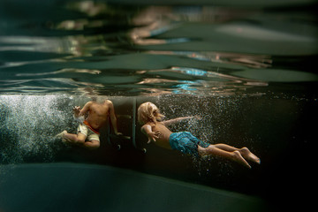 Two children playing in pool
