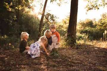 Children playing in woodland