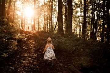 Young girl walking through woodland