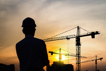portrait of engineer silhouette wear a helmet at construction si